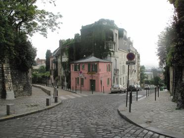 The same view of the rue des Saules today, showing La Maison Rose. [Public domain image.]